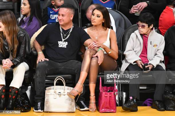 Vegas Dave and Holly Sonders attend a basketball game between the Los Angeles Lakers and the Los Angeles Clippers at Staples Center on December 25...