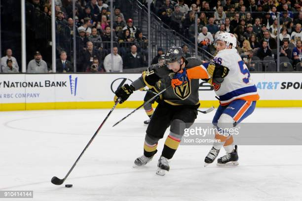 Vegas Golden Knights center Cody Eakin and New York Islanders center Tanner Fritz battle for control of the puck during the second period of a...