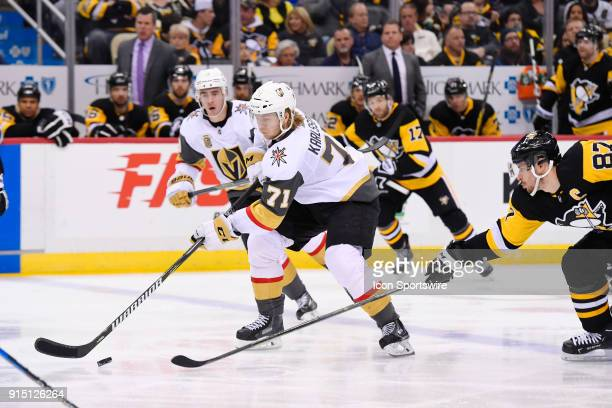 Vegas Golden Knights Center William Karlsson skates the puck into the zone while Pittsburgh Penguins Center Sidney Crosby defends during the third...