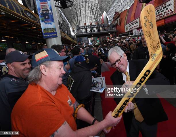 Vegas Golden Knights majority owner Bill Foley signs autographs for fans as he walks a red carpet at the Vegas Golden Knights Fan Fest at the Fremont...