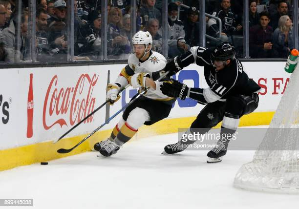 Vegas Golden Knights defenceman Colin Miller fights Los Angeles Kings center Anze Kopitar for the puck during the game on December 28 at the Staples...