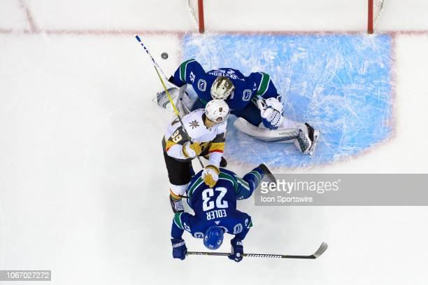 Vegas Golden Knights Defenceman Nate Schmidt checks Vancouver Canucks Defenseman Alexander Edler to the ice in front of Goaltender Jacob Markstrom...