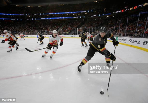 Vegas Golden Knights defenseman Colin Miller controls the puck during the first period of a regular season NHL game between the Calgary Flames and...