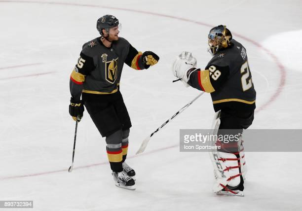 Vegas Golden Knights defenseman Jon Merrill fist bumps Vegas Golden Knights goalie MarcAndre Fleury after scoring a goal during the third period of a...