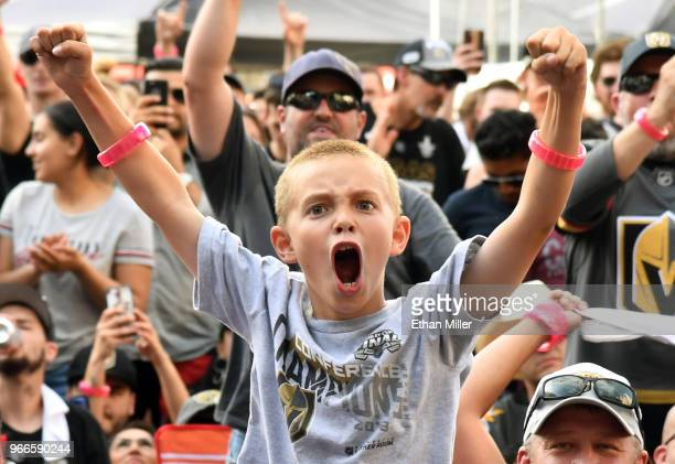 Vegas Golden Knights fan Andrew Kennedy of Nevada cheers as players are introduced during a Golden Knights road game watch party for Game Three of...