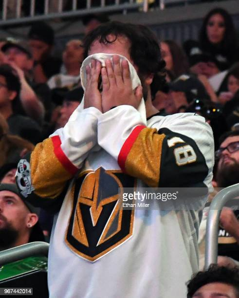 Vegas Golden Knights fan Brock Williams of Nevada reacts after a firstperiod goal by Devante SmithPelly of the Washington Capitals against the Golden...