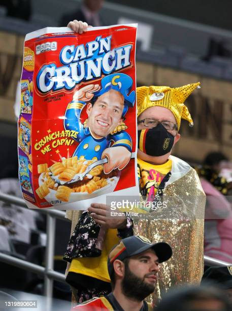 Vegas Golden Knights fan holds up a sign with an image of team captain Mark Stone on a Cap'n Crunch cereal box before Game Five of the First Round of...