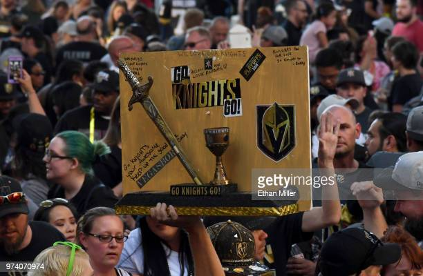Vegas Golden Knights fan holds up a wooden sign during the team's 'Stick Salute to Vegas and Our Fans' event at the Fremont Street Experience on June...