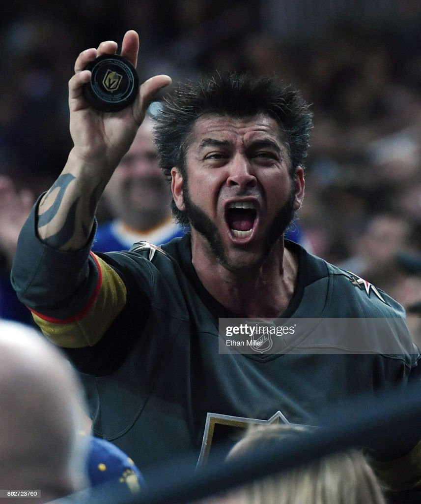Vegas Golden Knights fan Jason Greigo of Nevada reacts after he got a puck that was hit into the crowd during the first period of the team's game against the Buffalo Sabres at T-Mobile Arena on October 17, 2017 in Las Vegas, Nevada. The Golden Knights won 5-4 in overtime.
