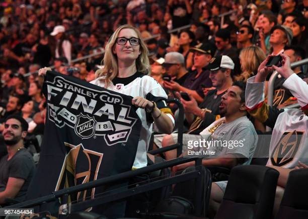 Vegas Golden Knights fan Sarah Klopp holds a Golden Knights Stanley Cup Final banner during a Golden Knights road game watch party for Game Four of...