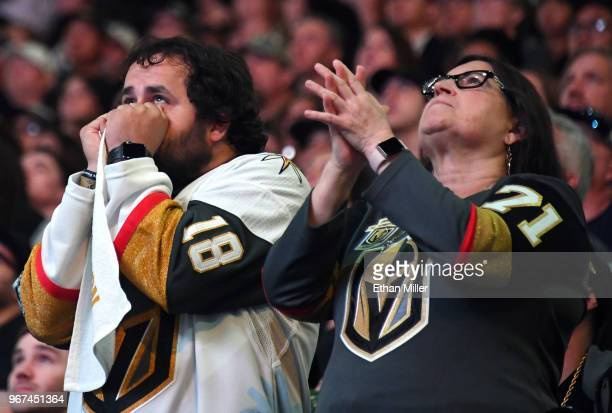 Vegas Golden Knights fans Brock Williams and Pamela Salas both of Nevada react during a Golden Knights road game watch party for Game Four of the...