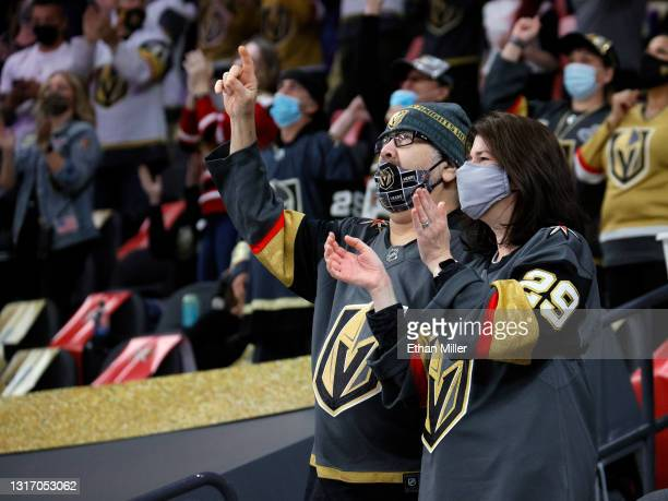 Vegas Golden Knights fans celebrate after a first-period goal by Reilly Smith of the Golden Knights against the St. Louis Blues during their game at...
