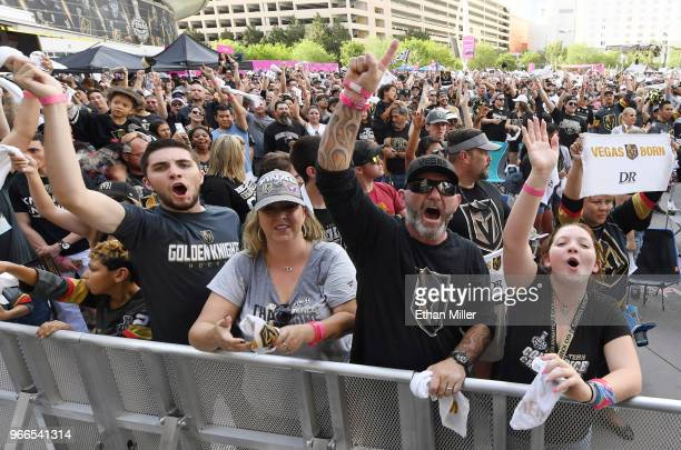 Vegas Golden Knights fans cheer during a Golden Knights road game watch party for Game Three of the 2018 NHL Stanley Cup Final between the Washington...