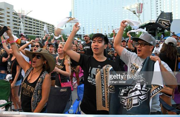Vegas Golden Knights fans Dion Glenn Ryen Sugimoto and Rich Sugimoto all of Nevada react after Tomas Nosek of the Golden Knights scored a thirdperiod...