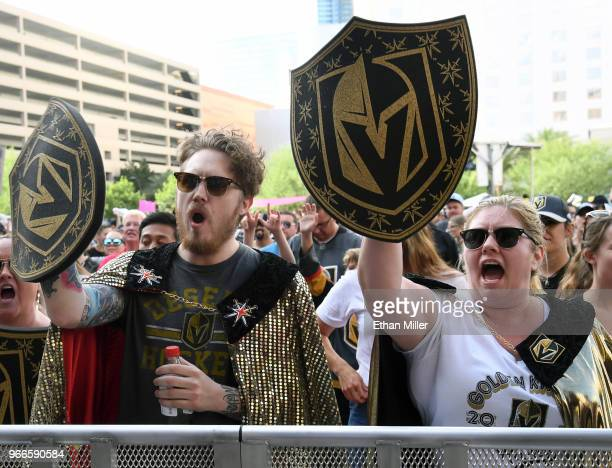 Vegas Golden Knights fans Dylan Eggert and Gina Eggert both of of Nevada cheer during a Golden Knights road game watch party for Game Three of the...