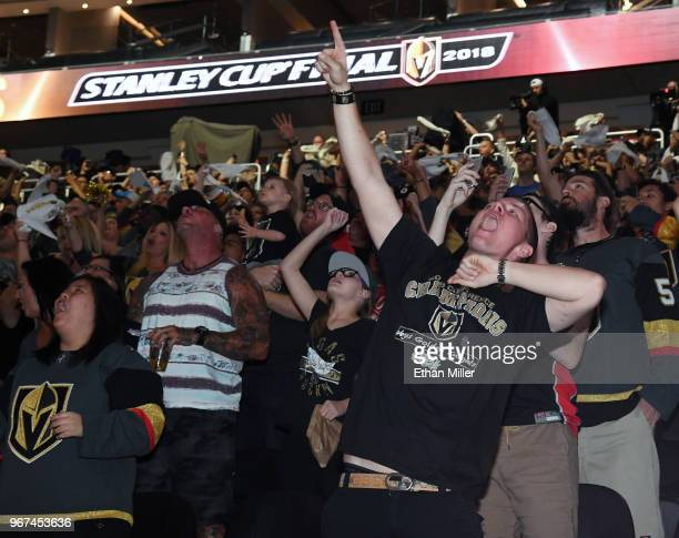 Vegas Golden Knights fans including Brandon Varela of Nevada cheer during a Golden Knights road game watch party for Game Four of the 2018 NHL...