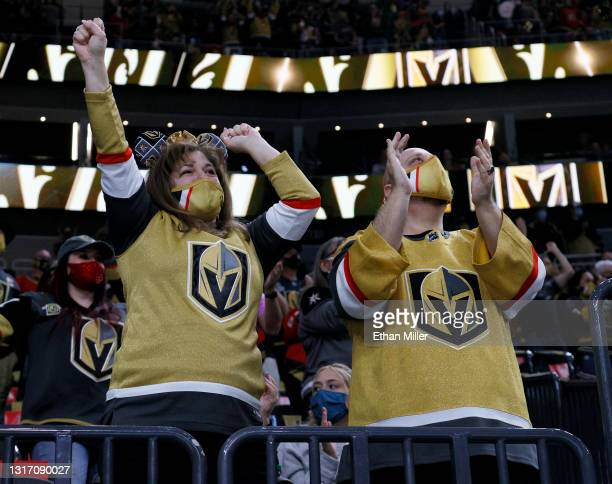 Vegas Golden Knights fans Irene Wandtke and Rich Wandtke, both of Nevada, cheer after Chandler Stephenson of the Golden Knights scored a first-period...