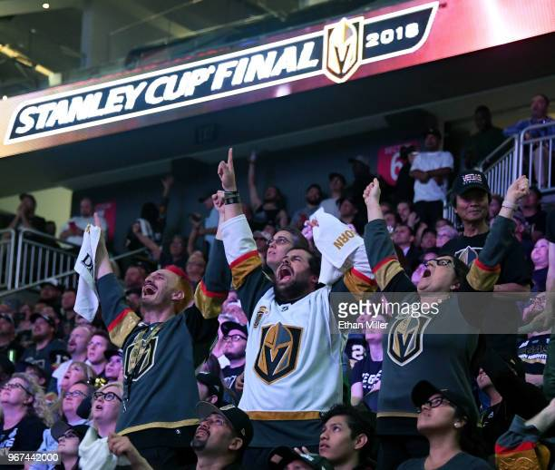 Vegas Golden Knights fans Jay BryantChavez Brock Williams and Pamela Salas all of Nevada react during a Golden Knights road game watch party for Game...