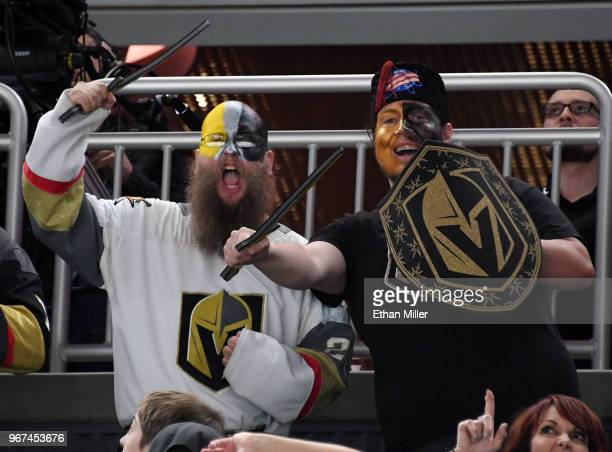 Vegas Golden Knights fans pose at a Golden Knights road game watch party for Game Four of the 2018 NHL Stanley Cup Final between the Golden Knights...