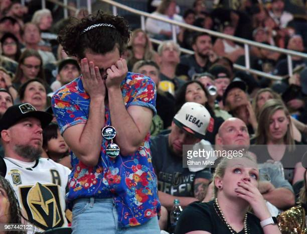 Vegas Golden Knights fans react after a firstperiod goal by Devante SmithPelly of the Washington Capitals against the Golden Knights during a Golden...