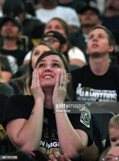 Vegas Golden Knights fans react after a firstperiod goal by TJ Oshie of the Washington Capitals against the Golden Knights during a Golden Knights...