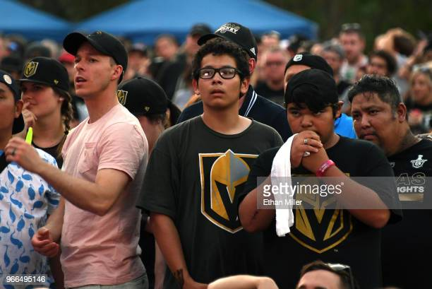 Vegas Golden Knights fans react after Devante SmithPelly of the Washington Capitals scored a thirdperiod goal against the Golden Knights at a Golden...