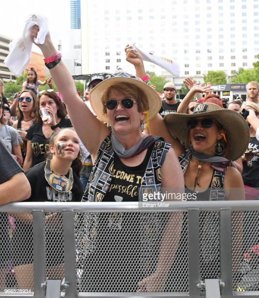 Vegas Golden Knights fans Shelley Packer and Dion Glenn both of Nevada cheer as players are introduced during a Golden Knights road game watch party...