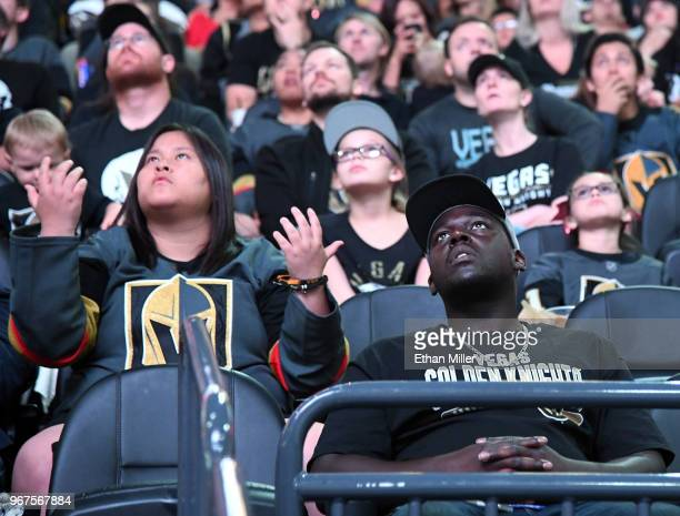 Vegas Golden Knights fans stare up at the scoreboard showing the game after a firstperiod goal by Tom Wilson of the Washington Capitals against the...