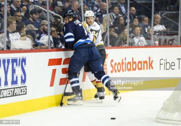 Vegas Golden Knights forward Oscar Lindberg bodies Winnipeg Jets defenseman Ben Chiarot during the NHL game between the Winnipeg Jets and the Vegas...