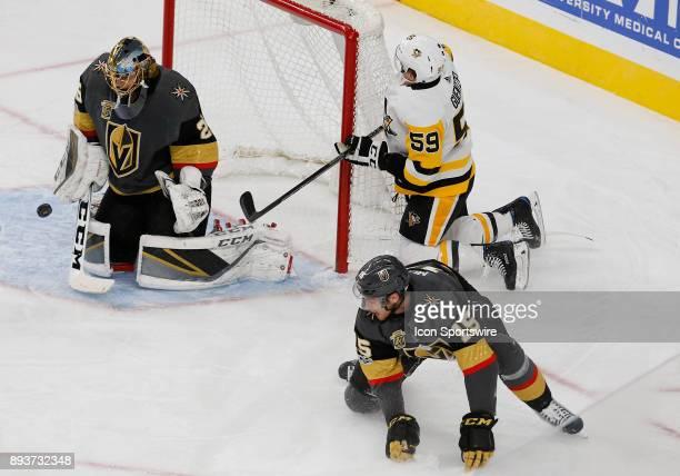 Vegas Golden Knights goalie MarcAndre Fleury blocks a shot from Pittsburgh Penguins center Jake Guentzel during the first period of a regular season...