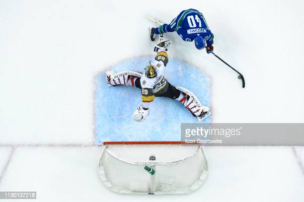 Vegas Golden Knights Goalie Marc-Andre Fleury makes a save on Vancouver Canucks Center Elias Pettersson during their NHL game at Rogers Arena on...