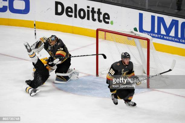 Vegas Golden Knights Goalie MarcAndre Fleury takes Pittsburgh Penguins Right Wing Patric Hornqvist down onto the ice in front of the crease during...