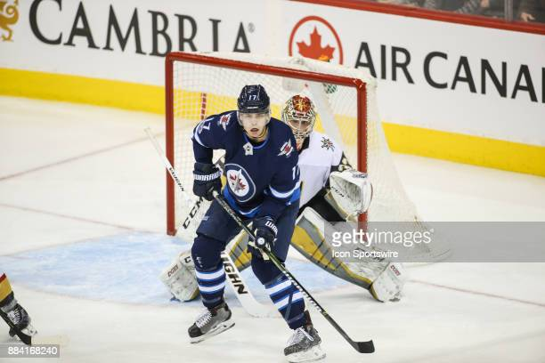 Vegas Golden Knights goalie Maxime Lagace is screened by Winnipeg Jets forward Brandon Tanev during the NHL game between the Winnipeg Jets and the...