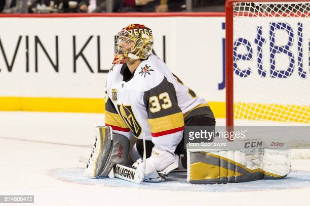 Vegas Golden Knights Goalie Maxime Lagace stretches after replacing starting goalie Oscar Dansk during the second period of a regular season NHL game...