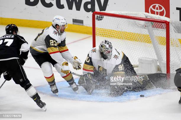 Vegas Golden Knights Goalie Robin Lehner makes a save as Vegas Golden Knights Defenceman Alec Martinez and Los Angeles Kings Right Wing Austin Wagner...