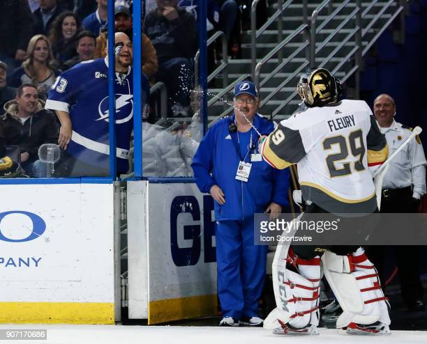 Vegas Golden Knights goaltender MarcAndre Fleury sprays a Lightning fan with water as he skates by during a time out in the second period of the NHL...