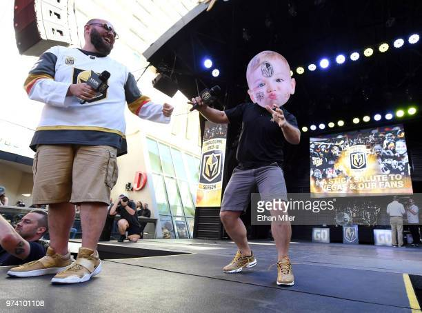 Vegas Golden Knights hosts Wayne 'Big D' Danielson and Mark Shunock joke around with a fan's Halloween baby mask during the team's 'Stick Salute to...