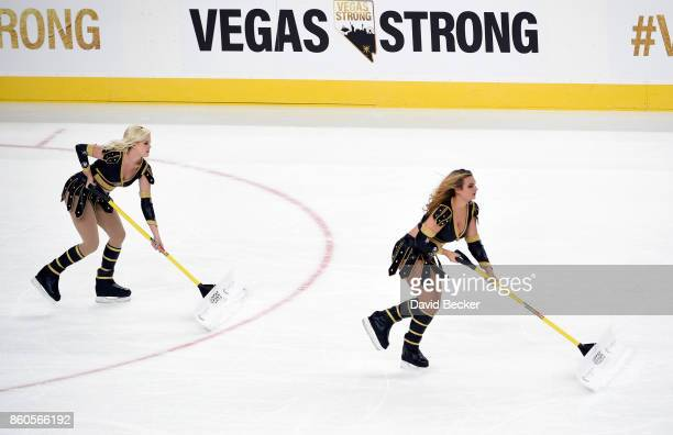 Vegas Golden Knights ice girls clean the ice during a timeout between the Vegas Golden Knights and the Arizona Coyotes at TMobile Arena on October 10...