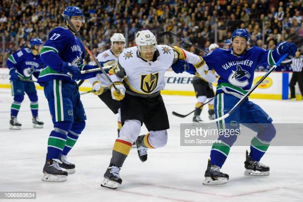 Vegas Golden Knights Left Wing Max Pacioretty skates past Vancouver Canucks Defenseman Troy Stecher and Defenseman Ben Hutton during their NHL game...