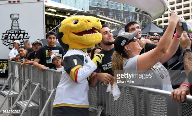 Vegas Golden Knights mascot Chance the Golden Gila Monster poses for photos with fans during a Golden Knights road game watch party for Game Three of...