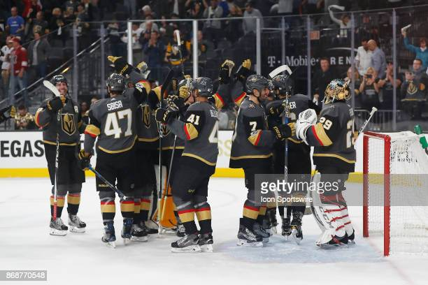 Vegas Golden Knights players celebrate after winning the firstever home game 52 versus the Arizona Coyotes on October 10 2017 at TMobile Arena in Las...