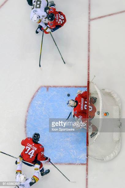 Vegas Golden Knights right wing Alex Tuch shoots in the first period against Washington Capitals goaltender Philipp Grubauer on February 4 at the...