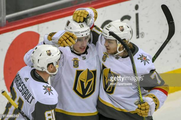 Vegas Golden Knights right wing Reilly Smith is congratulated by center Jonathan Marchessault and center William Karlsson after his third period goal...