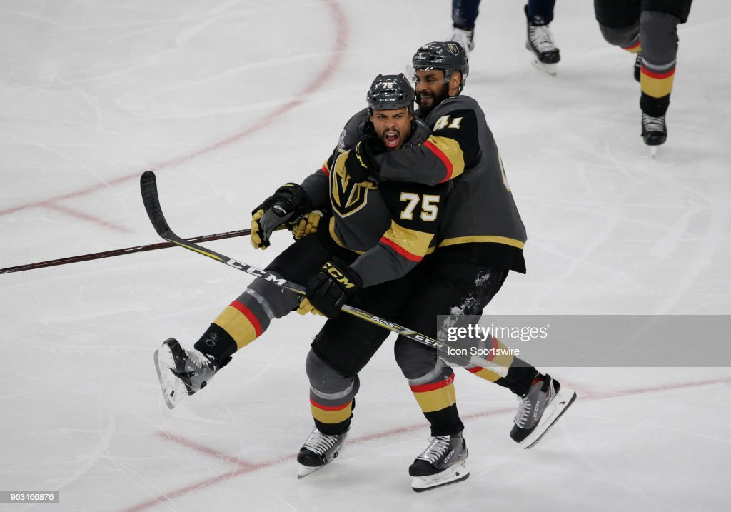 Vegas Golden Knights Right Wing Ryan Reaves (75) and Center Pierre-Edouard Bellemare (41) celebrate after scoring a goal during the third period of Game One of the Stanley Cup Final between the Washington Capitals and the Vegas Golden Knights, Monday, May 28, 2018, at T-Mobile Arena in Las Vegas, NV.