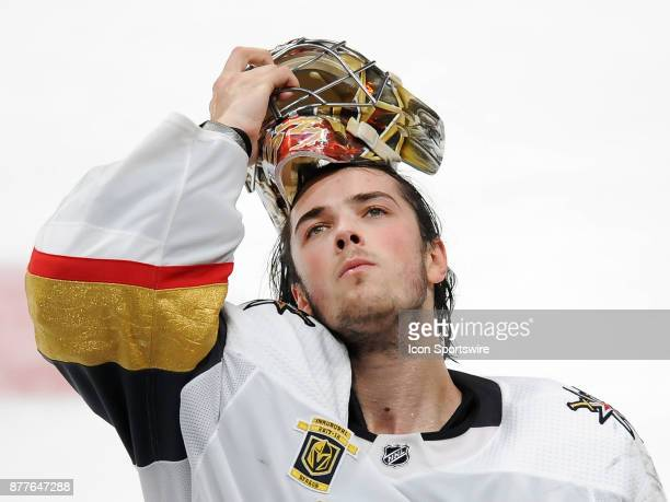 Vegas Golden Nights goalie Maxime Lagace puts on his mask during a break in the action of the third period of a game against the Anaheim Ducks on...