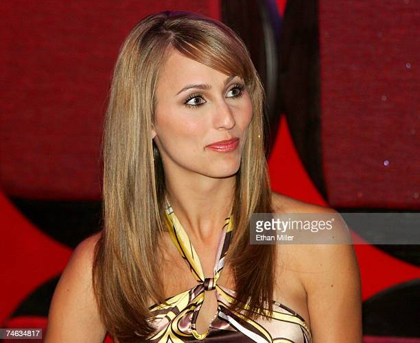 Vegas Minute host Danielle Demski watches the five Vegascom commercial contest finalists at a CineVegas film festival party at the EXTRA Lounge at...