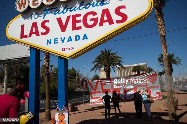 A 'Vegas Strong' banner hangs near the 'Welcome to Fabulous Las Vegas' sign at the south end of the Las Vegas Strip October 5 2017 in Las Vegas...