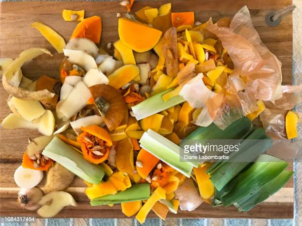 vegetable and butternut squash peelings on a table - 皮をむく ストックフォトと画像