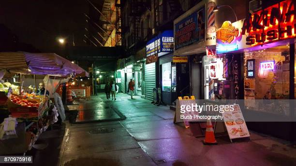 Vegetable and fruit concession stands along sidewalk in Chelsea, Manhattan, New York City