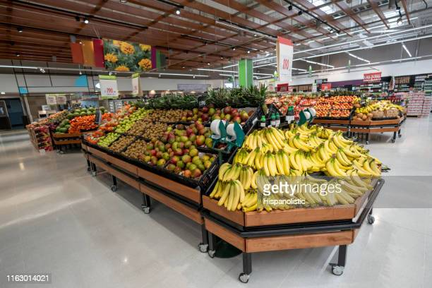 vegetable and fruit section at a supermarket - no people - retail display stock pictures, royalty-free photos & images